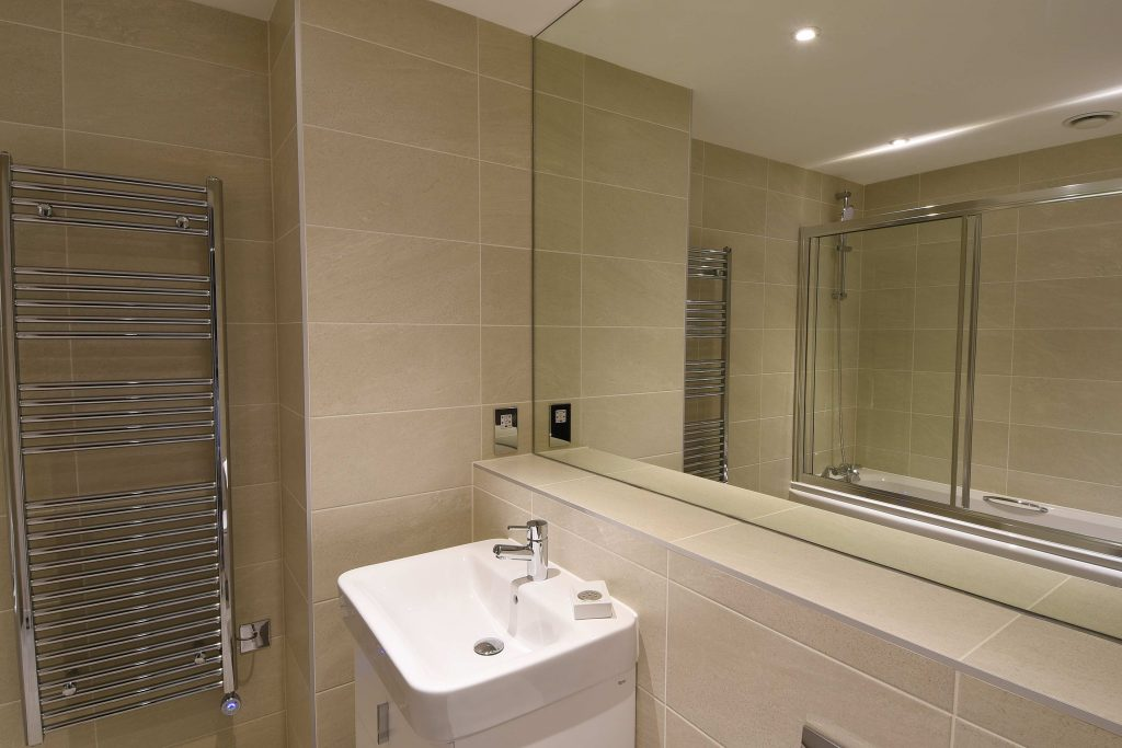Bathroom of the Burford Suite: a luxury serviced apartment at The Old Gaol by the river Thames in Abingdon. Ideal accommodation for business or holiday short lets