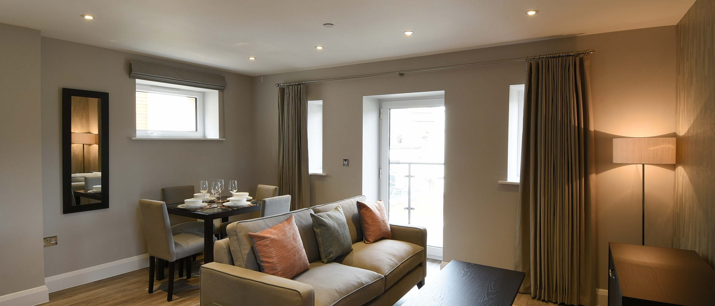 Living area of the Daniel Harris Suite: a one bedroom luxury serviced apartment at The Old Gaol, by the River Thames in Abingdon, near Oxford. Ideal accommodation for corporate or holiday short lets