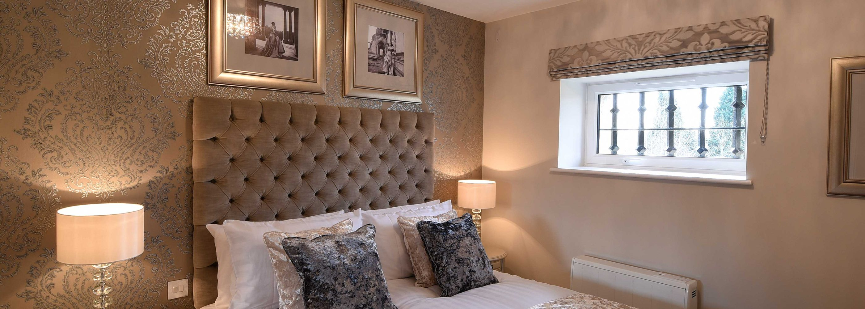 The bedroom in the Roysse Suite: a one bedroom luxury serviced apartment at The Old Gaol, by the River Thames in Abingdon, near Oxford. Ideal accommodation for corporate or holiday short lets