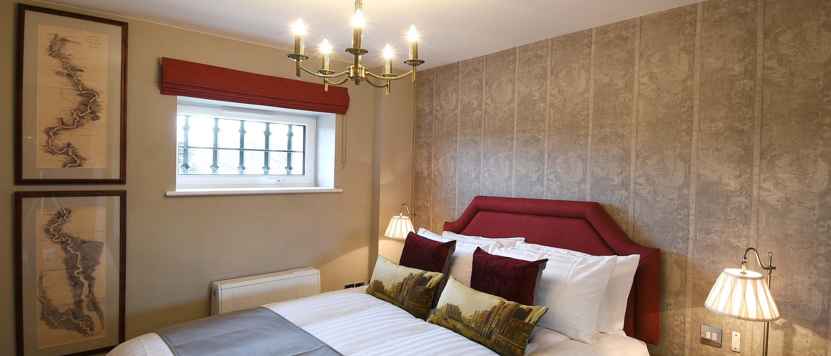 The bedroom in the Tomkins Suite: a one bedroom luxury serviced apartment at The Old Gaol, by the River Thames in Abingdon, near Oxford. Ideal accommodation for corporate or holiday short lets