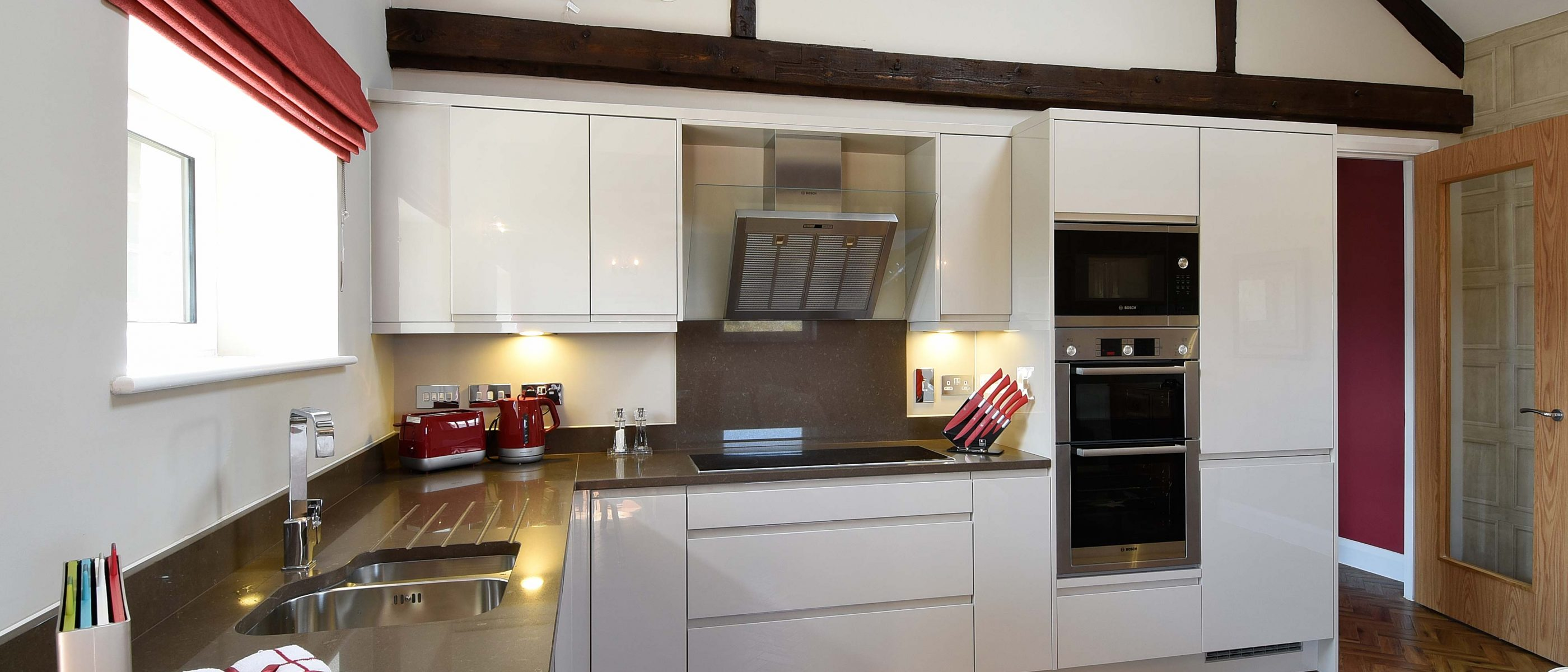 The kitchen in the Tomkins Suite: a one bedroom luxury serviced apartment at The Old Gaol, by the River Thames in Abingdon, near Oxford. Ideal accommodation for corporate or holiday short lets