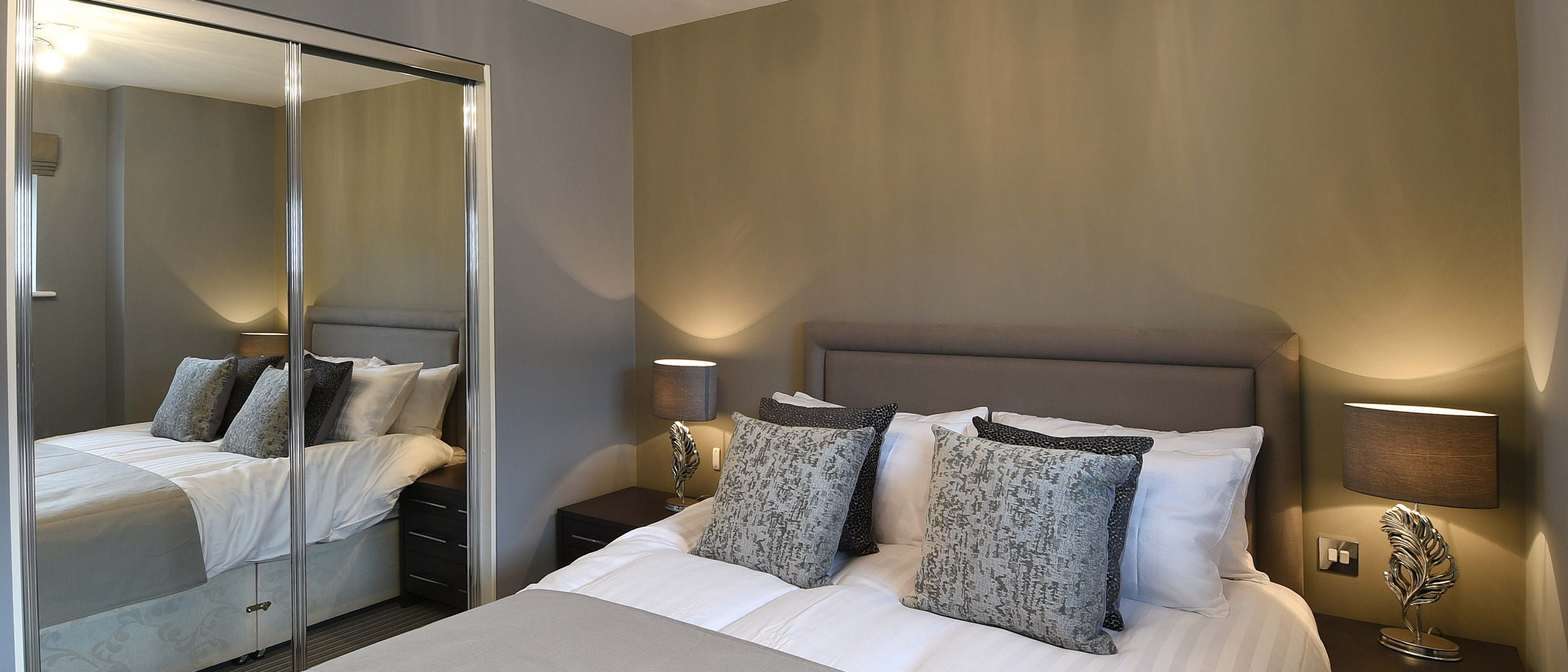 The bedroom in the Morland Suite: a one bedroom luxury serviced apartment at The Old Gaol, by the River Thames in Abingdon, near Oxford. Ideal accommodation for corporate or holiday short lets