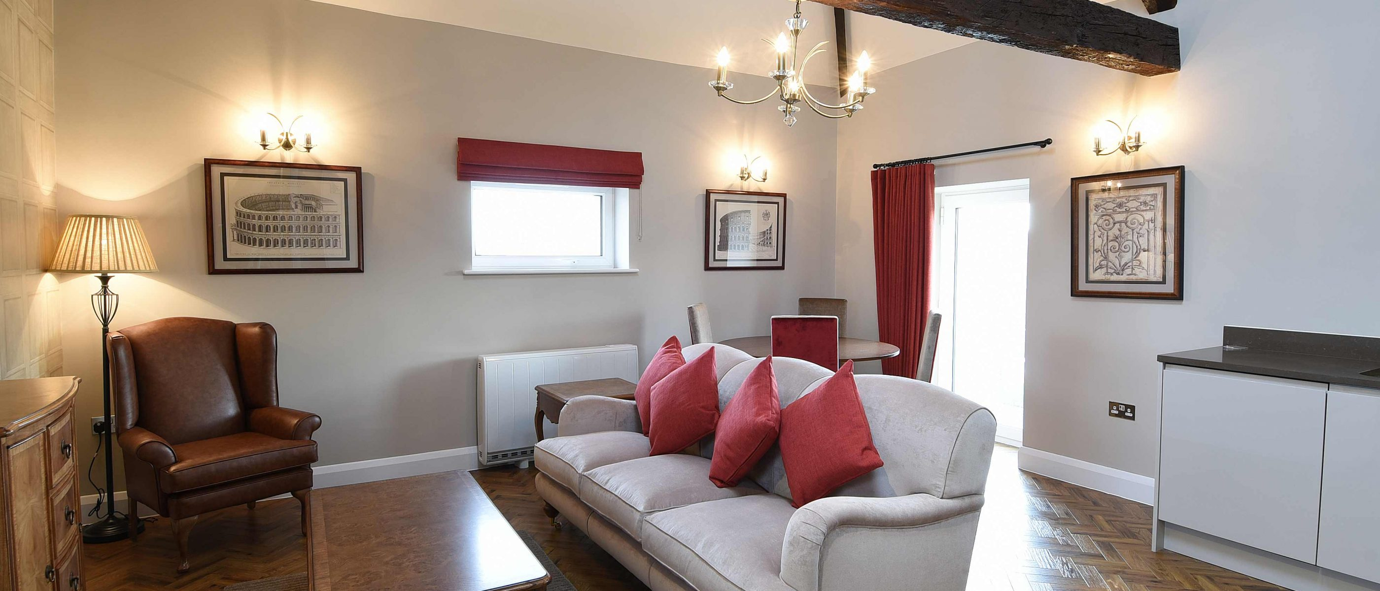 Living area in the Tomkins Suite: a one bedroom luxury serviced apartment at The Old Gaol, by the River Thames in Abingdon, near Oxford. Ideal accommodation for corporate or holiday short lets